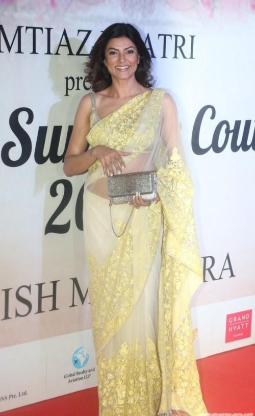 Yay or Nay? Sushmita Sen  wearing a beautiful yellow net saree at the Mijwan summer fashion show by Manish Malhotra - SeenIt