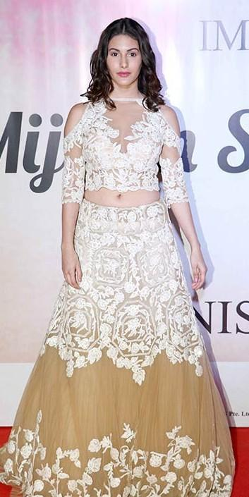 Yay or Nay? Amyra Dastur wearing an embroidered white crop top and skirt outfit at the Mijwan summer fashion show by Manish Malhotra held in Mumbai last night - SeenIt