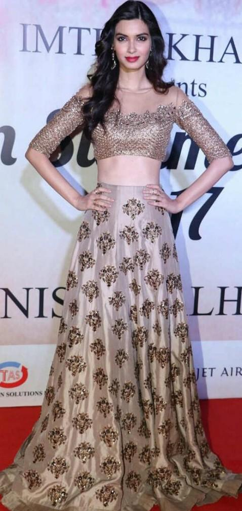 Yay or Nay? Diana Penty wearing a golden silk crop top and skirt outfits  at the Mijwan summer fashion show by Manish Malhotra held in Mumbai last night - SeenIt