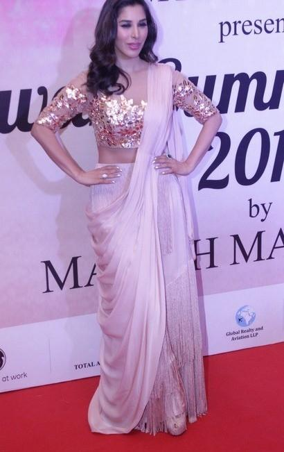 Yay or Nay? Sophie Chaudhary wearing a sequin clad blouse  saree at the Mijwan summer fashion show by Manish Malhotra - SeenIt