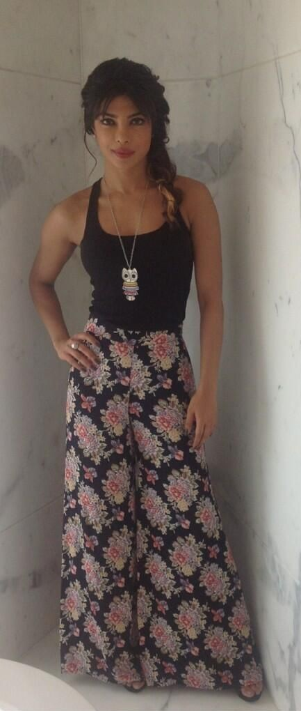 Want similar black tank top with floral palazzo pants and the owl necklace that Priyanka Chopra is wearing - SeenIt