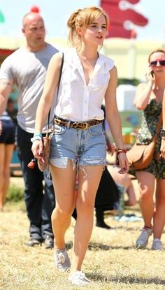 Looking for this white sleeveless shirt with blue ripped denim shorts that Emma Watson is wearing - SeenIt