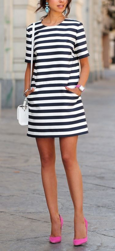 Looking for a similar navy blue and white striped dress along with the pink stiletto pumps. - SeenIt