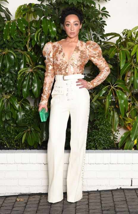 Yay or Nay? Ruth Negga in this golden embellished shirt top and white pants. - SeenIt