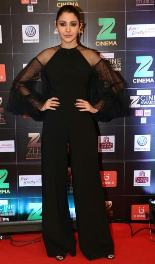 Yay or Nay? Anushka Sharma wearing a black jumpsuit with sheer and dramatic detailing on the sleeves at the Zee Cine awards 2017 - SeenIt