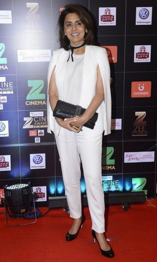 Yay or Nay? Neetu Singh wearing a white cape sleeve coat with trousers at the red carpet , Zee Cine awards 2017 - SeenIt