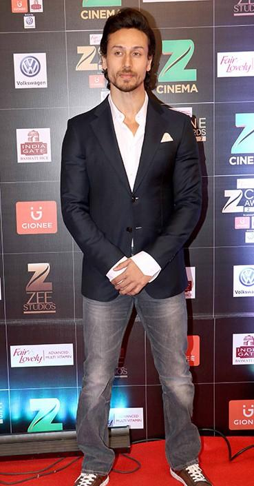 Yay or Nay? Tiger Shroff keeping it semi formal with a pair of denims and a blazer at the Zee Cine awards , red carpet 2017 - SeenIt