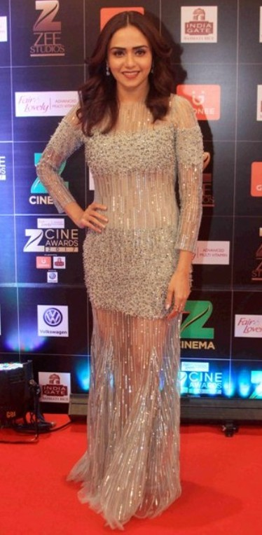 Yay or Nay? Amruta Khanvilkar wearing a silver sheer shimmer fringed gown at the Zee Cine awards 2017 - SeenIt