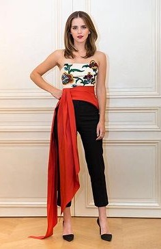 Yay or Nay? Emma Watson in this white floral crop top with black pants with a red ribbon belt - SeenIt