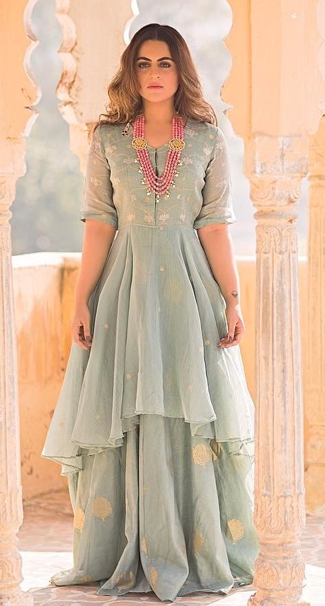Yay or Nay? Shereen Sikka wearing a mint green embroidered anarkali lehenga. - SeenIt