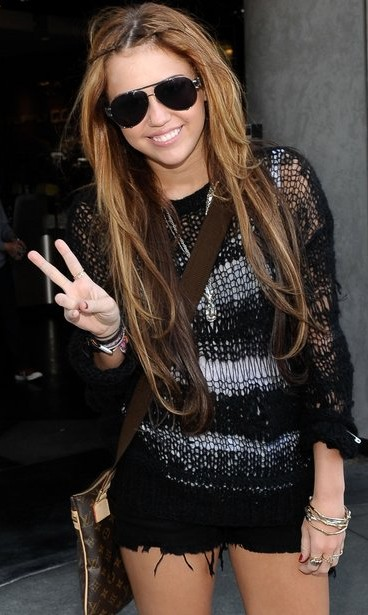 Help me find similar black aviators that Miley Cyrus is wearing - SeenIt