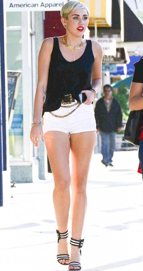 Help me find the outfit that Miley Cyrus is wearing. The black tank top and white shorts - SeenIt
