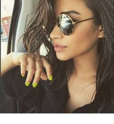 Want similar neon yellow nail polish that Shay Mitchell is wearing - SeenIt