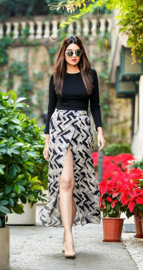 Help me get Madhura Bhogale's entire look! Black and grey geometric print maxi wrap skirt, black full sleeves top and nude stiletto pumps. - SeenIt