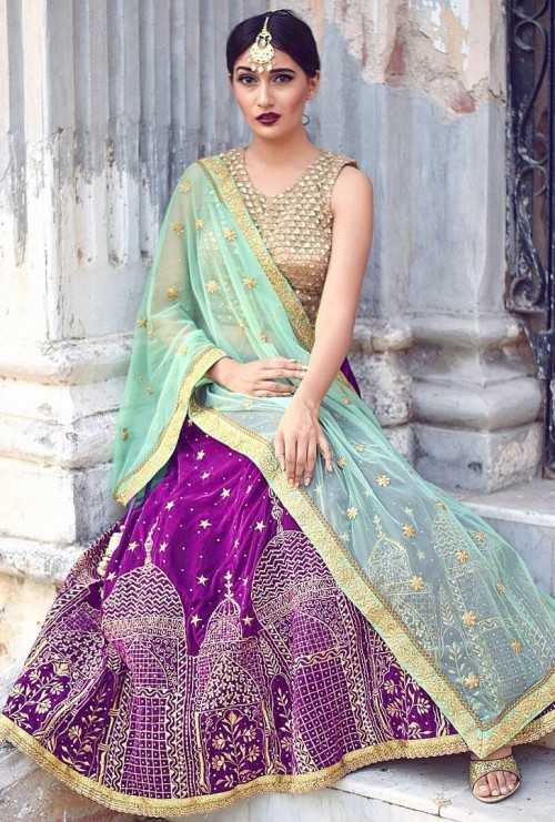 Yay or Nay? Vishwa Bhavsar in a purple embroidered lehenga with gold tone blouse and mint dupatta. - SeenIt