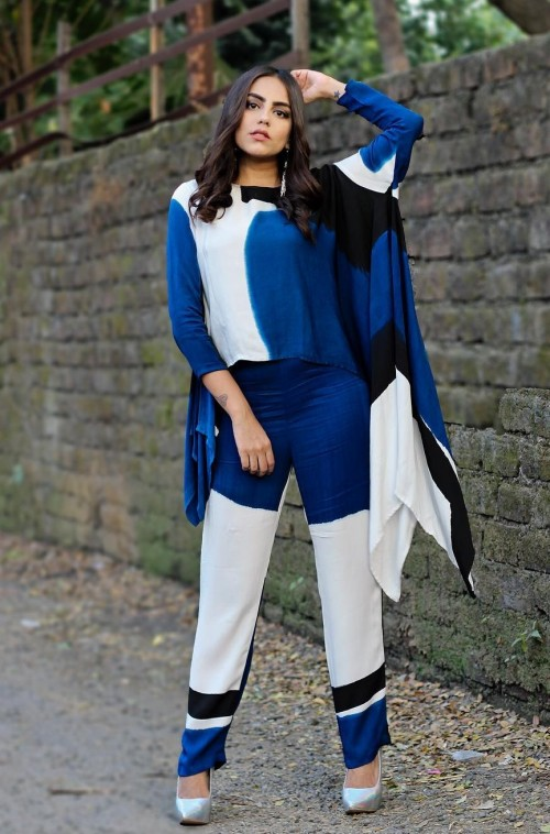Yay or Nay? This blue, white and black coords..asymmetric tunic and pants that Loveina Gwalani is wearing. - SeenIt