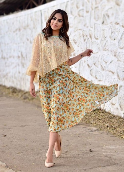 Yay or Nay? Loveina Gwalani in a mint green and yellow floral midi dress with beige sequin sheer cape. - SeenIt