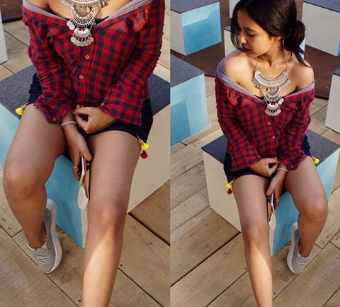 Yay or Nay? Blogger @happilyunemployed spotted at the Amazon fashion week wearing a checkered red off shoulder shirt with antique boho jewelry and shorts - SeenIt