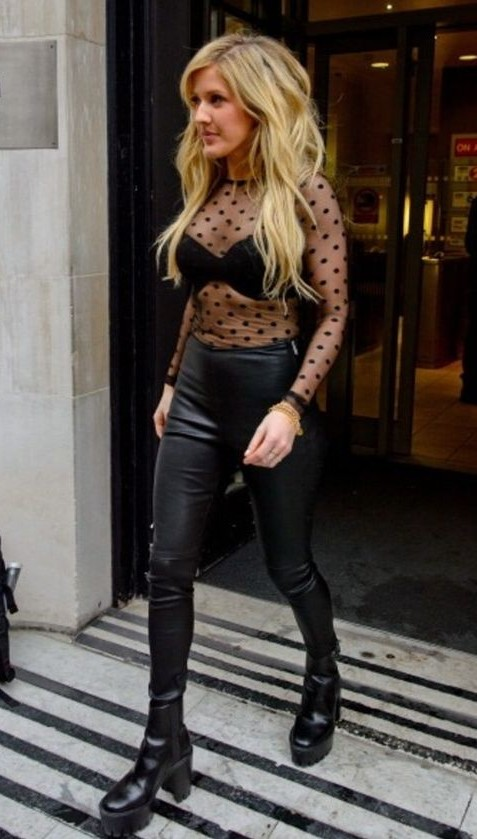 Looking for Ellie Goulding's entire outfit...black sheer top, leather pants and ankle boots. - SeenIt
