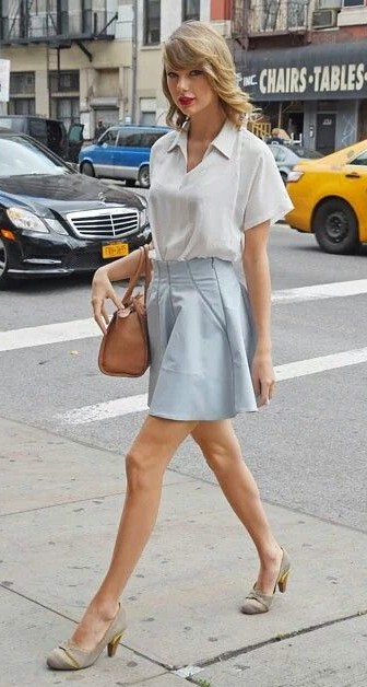 Looking for the blue skirt and the white shirt that Taylor Swift is wearing - SeenIt