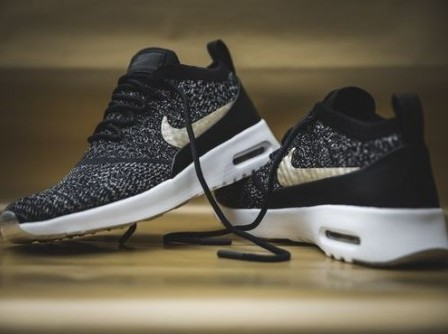 I am looking for these black sneakers with golden nike logo. - SeenIt