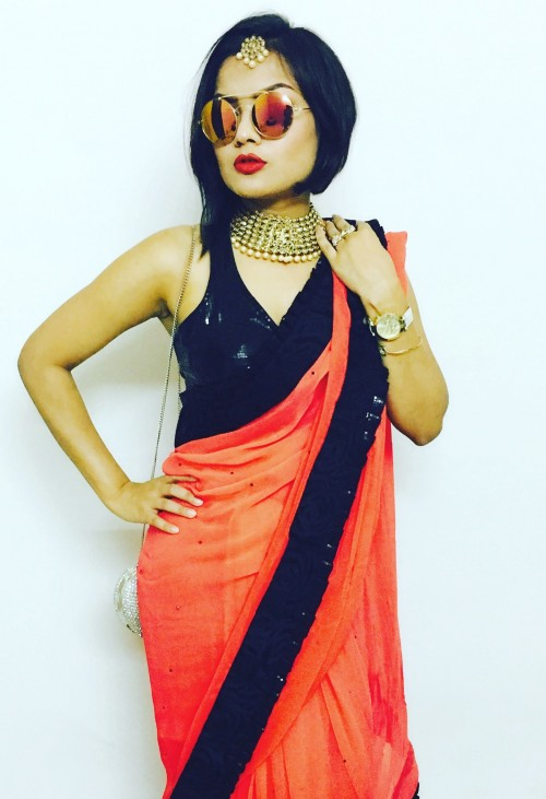 Yes or no? the orange and black saree - SeenIt
