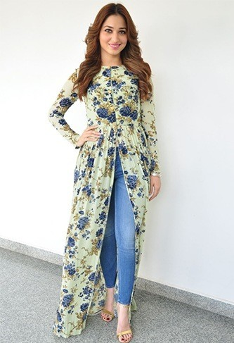 Looking for this long floral front high slit cape that Tamanna Bhatia is wearing - SeenIt