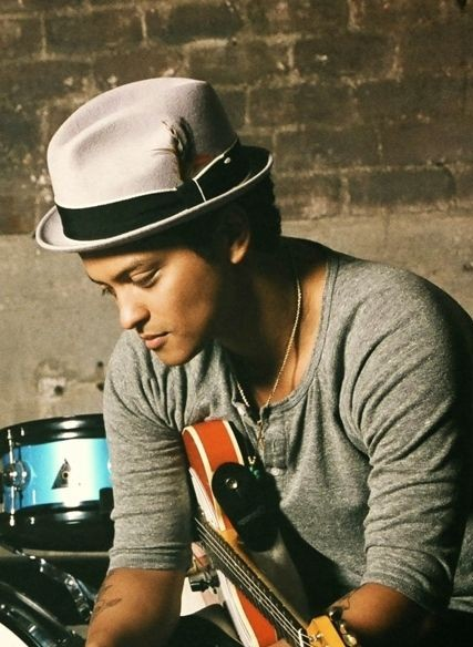 This Bruno Mars's white hat is what I am looking for. - SeenIt