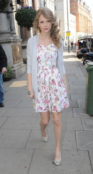 Looking for the similar white floral dress that Taylor Swift is wearing - SeenIt