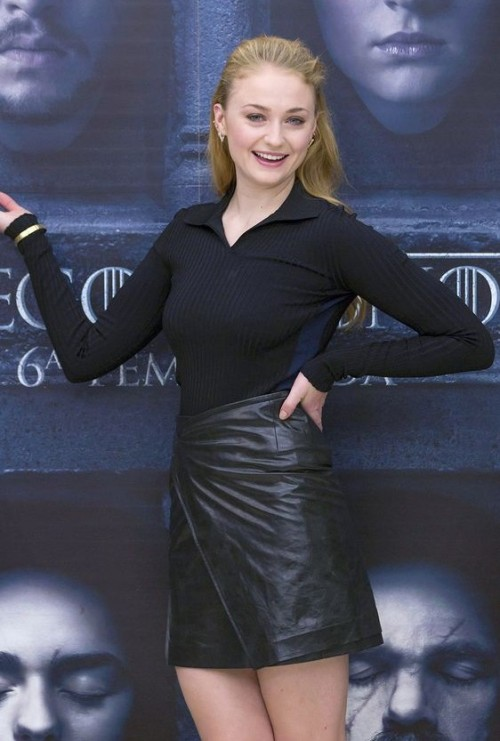 Can you help me find a similar black leather skirt that Sophie Turner is wearing? - SeenIt