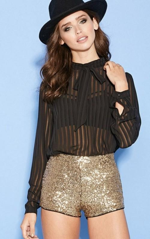 Looking for a similar black sheer shirt and golden sequin shorts! - SeenIt