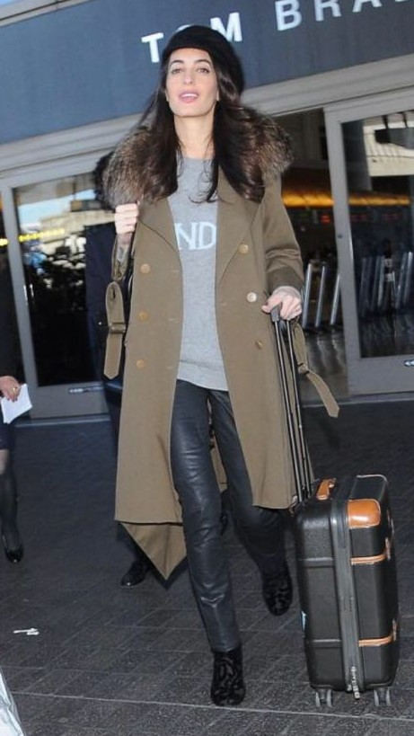 Looking for the light blue top with grey pants and the khaki colour trench coat that Amal Clooney is wearing - SeenIt