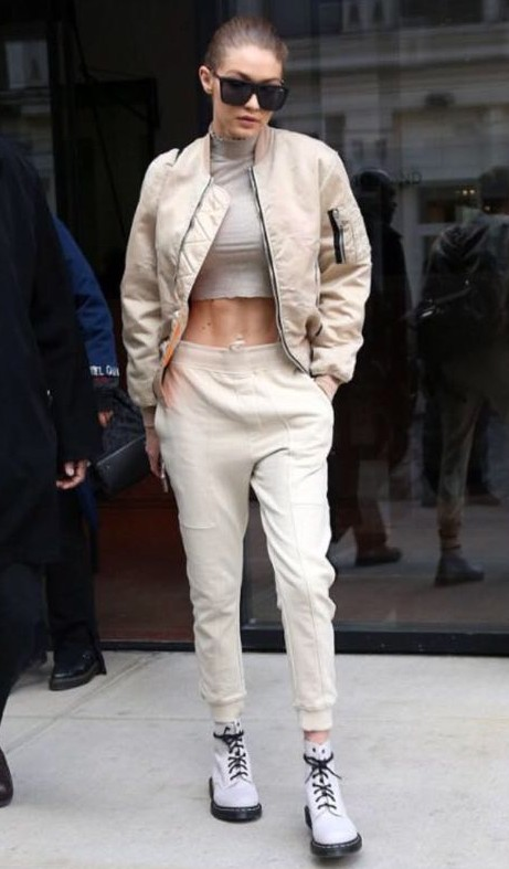 Help me find the ivory crop top and pants paired with cream bomber jacket that Gigi Hadid is  wearing - SeenIt