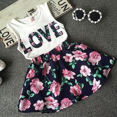Want this black and pink floral skirt and white printed top for my baby girl. - SeenIt