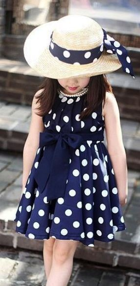 Need a similar navy blue polka dot dress for my little sister. - SeenIt