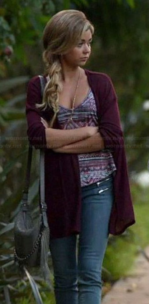 Looking for the purple shrug, aztec print top, black cross body and blue jeans that Haley Dunphy is wearing - SeenIt