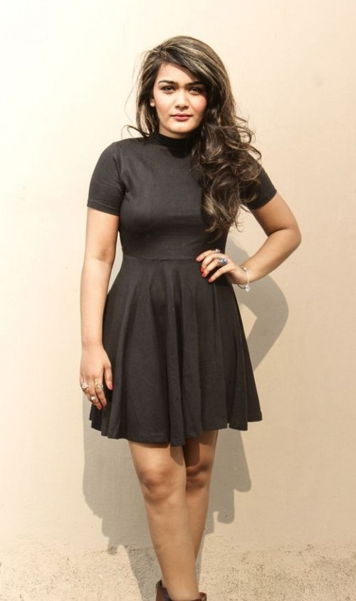 Would like to add this little black high neck skater dress that Riddhima Khanna is wearing to my wardrobe. - SeenIt