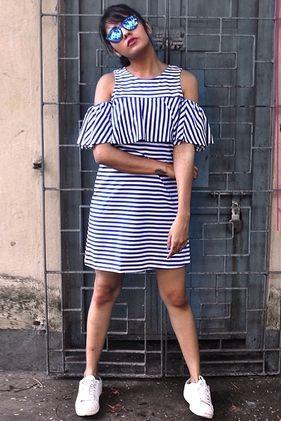 Want this navy blue and white striped cold shoulder ruffled dress. Any idea where to get it from? - SeenIt