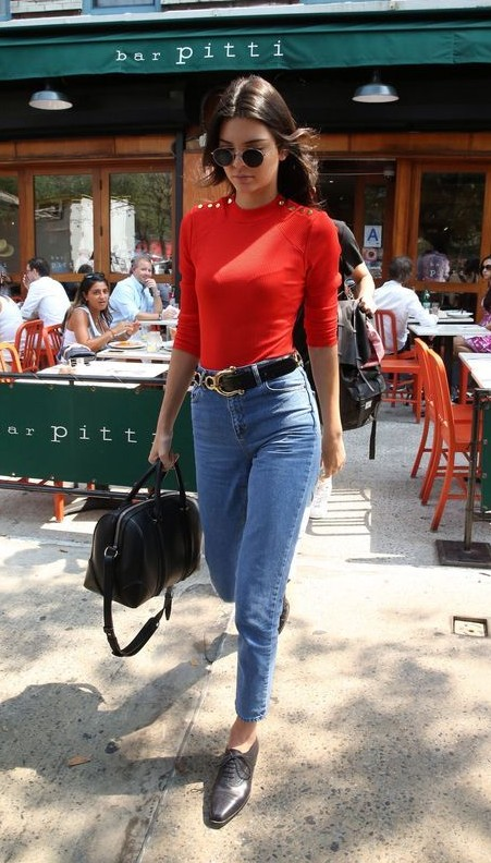 Looking for the red top with blue denim jeans and black oxford shoes that Kendall Jenner is wearing - SeenIt