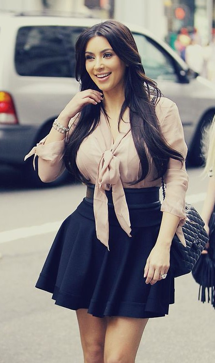 Help me find the beige bow shirt and black skater skirt as Kim Kardashian is wearing - SeenIt