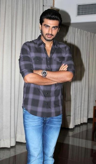 Help me find a similar grey checkered shirt and blue denim jeans that Arjun Kapoor is wearing - SeenIt