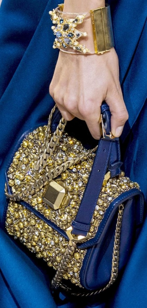 Yay or Nay? Navy blue top handle bag with golden embellishments. - SeenIt