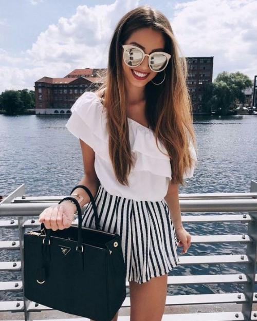 Looking for the one-shoulder ruffle top with black and white striped shorts along with the white sunglasses - SeenIt