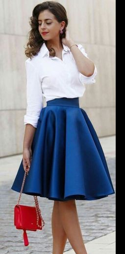 Looking for the white shirt with blue skater skirt and the orange handbag - SeenIt