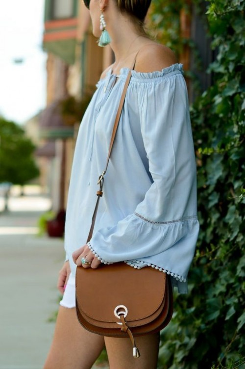 Find me the pastel blue bell sleeves off shoulder top and a similar brown sling bag. - SeenIt