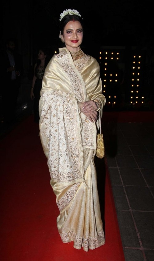 Yay or Nay? The Evergreen beauty Rekha wearing a golden saree at the Hello Hall of Fame awards 2017. - SeenIt