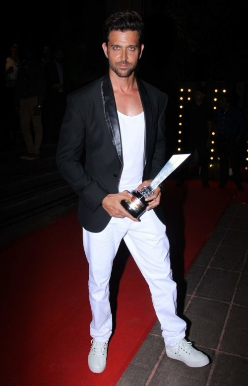 Yay or Nay? Hrithik Roshan looking chic in a black tuxedo blazer and white pants paired with white sneakers at the Hello Hall of Fame awards 2017. - SeenIt