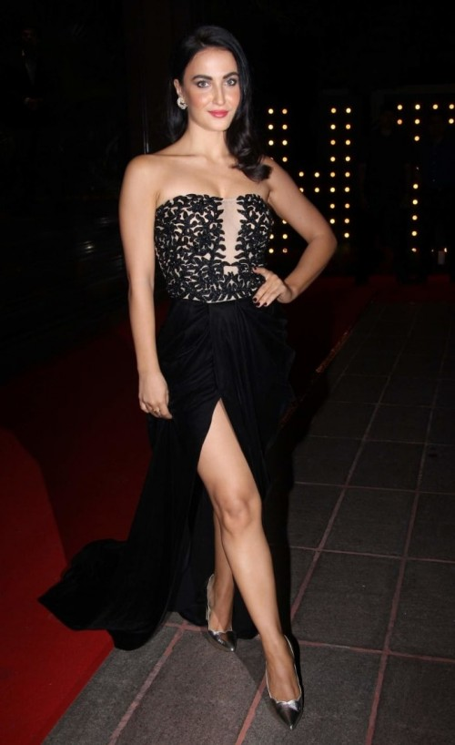 Yay or Nay? Elli Avram wearing a thigh high slit black strapless gown at the Hello Hall of Fame awards last night. - SeenIt