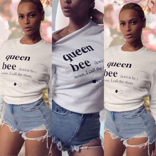 Help me find this white 'Queen bee' top and blue ripped denim shorts that Beyonce is wearing - SeenIt