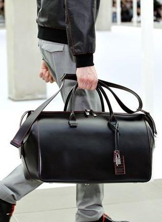 Similar shaped black leather duffel bag anyone?? - SeenIt